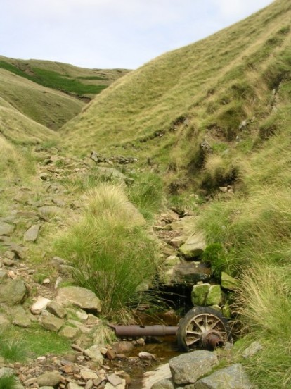 Undercarriage oleo from Douglas C-47A 42-108982 in Ashton Clough below Shelf Moor, Bleaklow