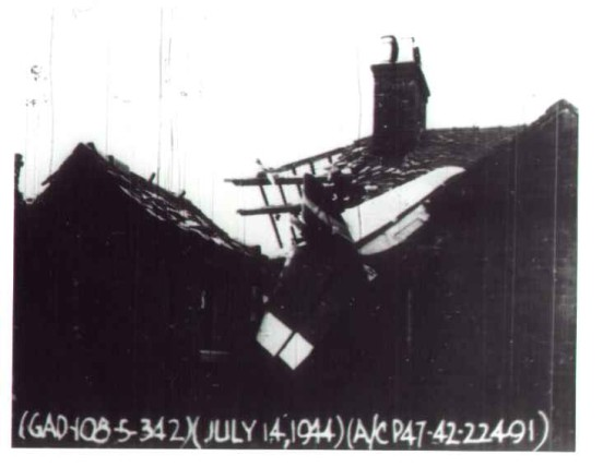 Accident report photograph showing the aftermath of the crash of Republic P-47D 42-22491 into houses on Riverside Road, Upper Tean, Staffordshire