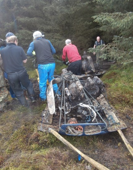 Dragging the engines from Cessna UC-78A Bobcat 42-58513 out of the forest on Craigton Hill, Milngavie