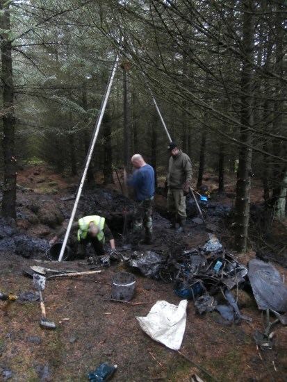 Shear legs being used at the crash site of UC-78A Bobcat 42-58513 on Craigton Hill by the Dumfries and Galloway Aviation Museum