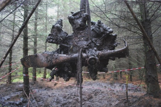 Lifting the starboard engine from the crash site of UC-78A Bobcat 42-58513 on Craigton Hill during excavation by the Dumfries and Galloway Aviation Museum