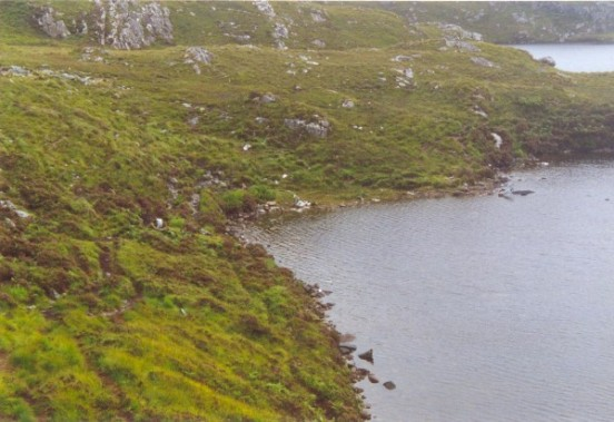 One of the Fairy Lochans below Sidhean Mor, with wreckage from B-24 42-95095 on its shore
