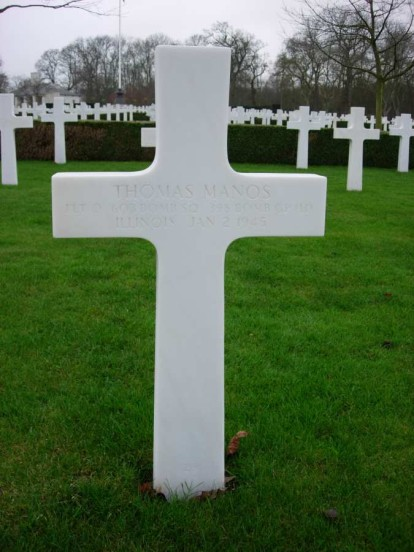Grave of Flight Officer Thomas Manos at Cambridge American Military Cemetery