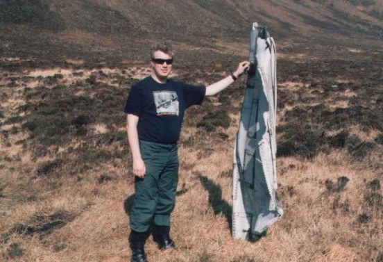 Alan with wreckage from below the crash site of Consolidated Liberator FL949, Cuilags, Island of Hoy, Orkney