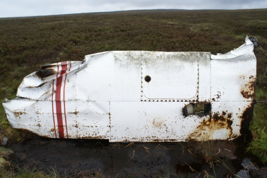 Wing at the crash site of Piper Cherokee G-AVYN at Ashfold Gill Head near Pateley Bridge, North Yorkshire