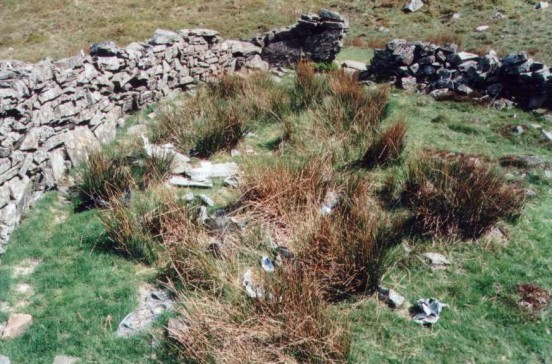 Wreckage in a sheepfold below the crash site of Handley Page Halifax JP182 on Eel Crag, Keswick