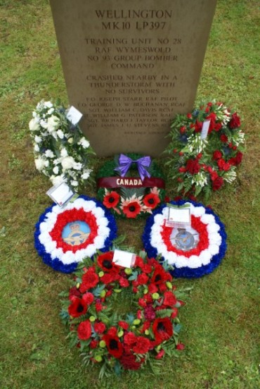 Wreaths laid around the memorial during the dedication ceremony