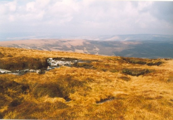 Scattered wreckage at the crash site of Canadair Sabre XD730 and XD707 on Kinder Scout, Derbyshire