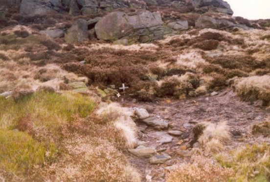 Crash site of Vickers Wellington Mk.IC W5719 on Far Upper Toor, Kinder Scout, Edale, with rock out crop behind