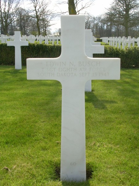 The grave of Technical Sergeant Edwin N. Busch at Cambridge American Cemetery, Madingley