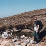 Alan with wreckage at the crash site of Consolidated Liberator FL949, Cuilags, Island of Hoy, Orkney